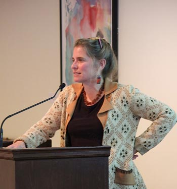 Miriam Zoll speaking at a conference